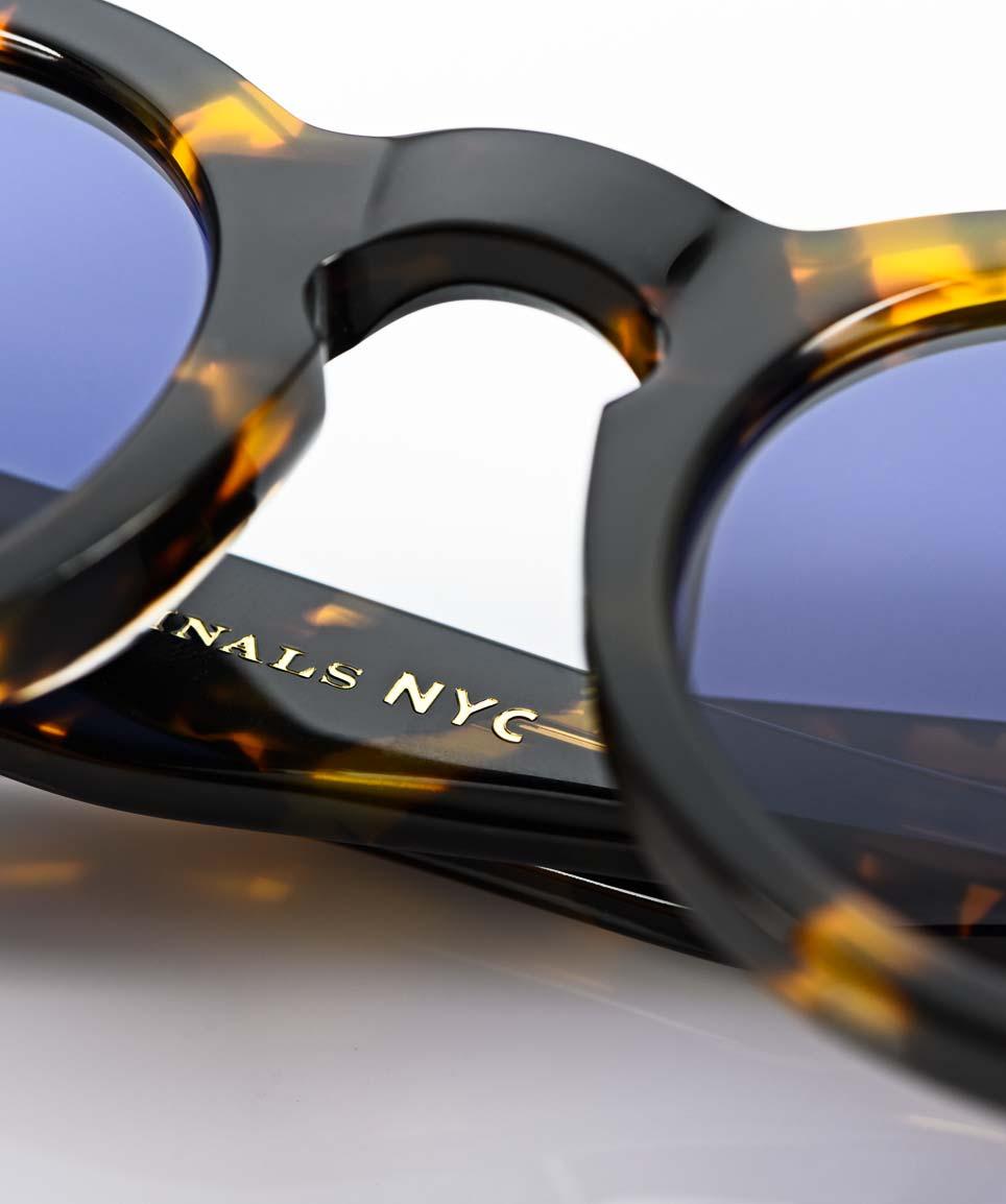 Moscot – runde Sonnenbrille aus havanna farbigem Kunststoff kombiniert mit blauen Gläsern - KITSCHENBERG Brillen