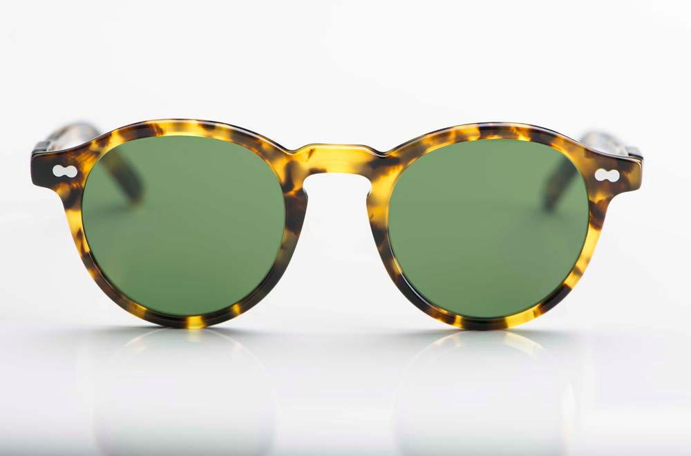 Moscot – Sonnenbrille – gelb schwarze havanna Kunststoff Brille in einer Pantoform mit grünen Gläsern - KITSCHENBERG Brillen