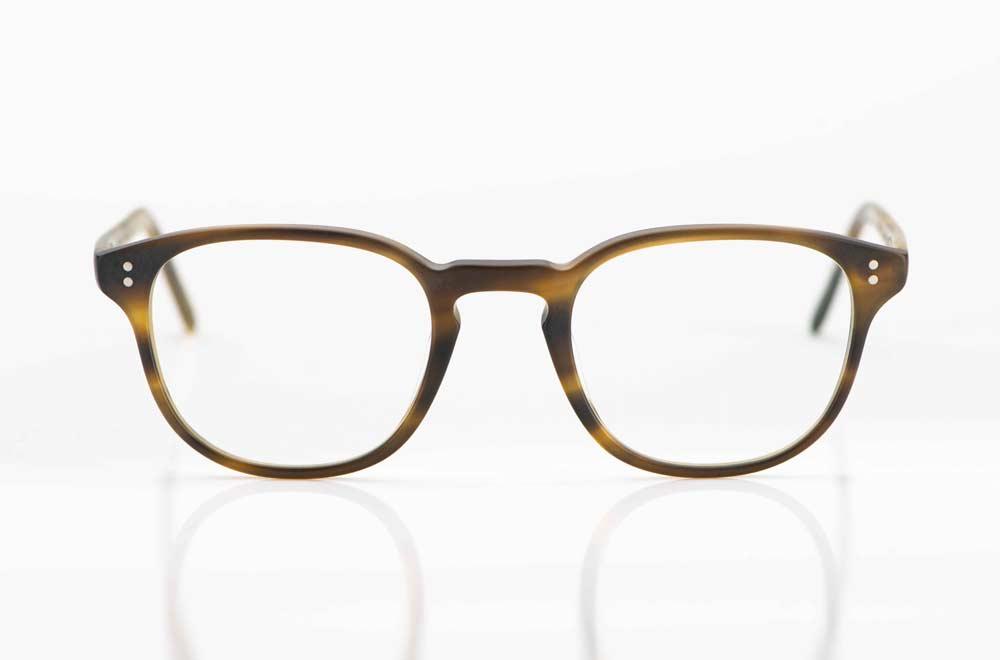 Oliver Peoples – leicht eckige Acetat Fassung mit Rundkopfnieten in einer matt oliv braunen Farbe - KITSCHENBERG Brillen